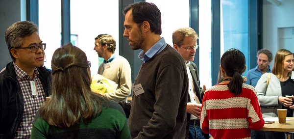 People networking at AIMday Materials event at the Ångström Laboratory
